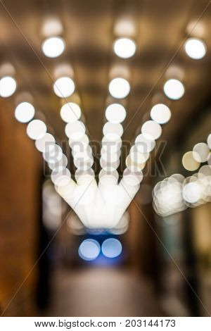 Abstract Bokeh Background Of Lights In Alley Passage Leading To Exit