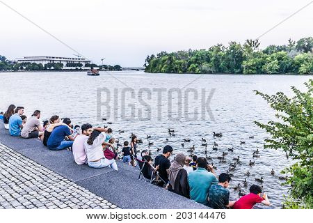 Washington Dc, Usa - August 4, 2017: People Sitting In Georgetown Park On Riverfront In Evening With