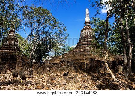 Wat Khao Suwankhiri temple ruins pagoda and bright sky in Sisatchanalai Historical Park Sukhothai province Thailand