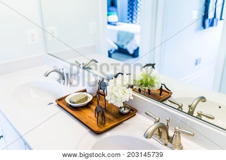 Closeup Of Modern Bathroom His And Her Sinks With White Countertop And Mirror In Staging Model Home,