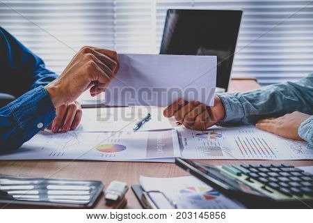 Businessman giving resignation letter to human resource manager