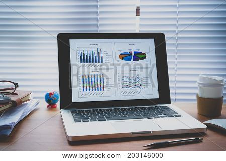 Graphic of business financial data analysis chart on laptop.Close up