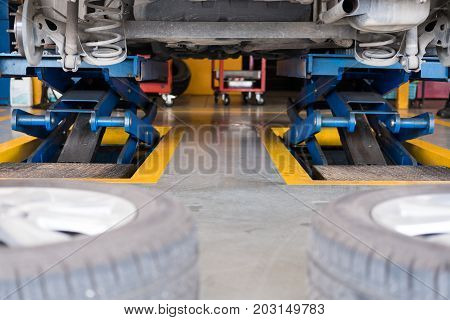 Undercarriage Of A Car In Garage. Vehicle Maintenance In Auto Repair Service. Automobile Annual Chec