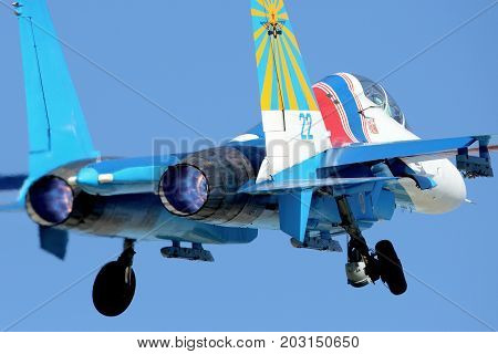 Kubinka, Moscow Region, Russia - August 21, 2014: Sukhoi Su-27UB 22 BLUE of russian knights aerobatics team taking off at Kubinka air force base.