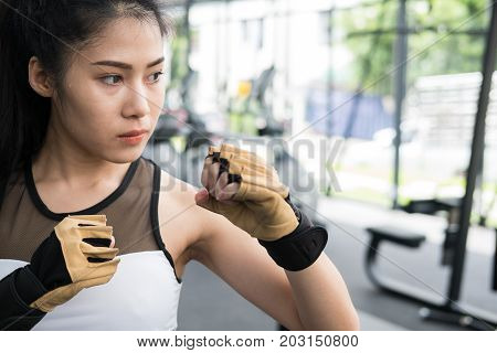 Young Woman Posing In Combat Stance In Fitness Center. Female Athlete Training In Gym. Sporty Girl W