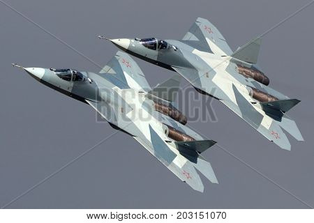 Zhukovsky, Moscow Region, Russia - August 24, 2013: Pair of Sukhoi T-50 PAK-FA 052 BLUE and 051 BLUE modern russian jet fighters performing demonstration flight in Zhukovsky during MAKS-2013 airshow.