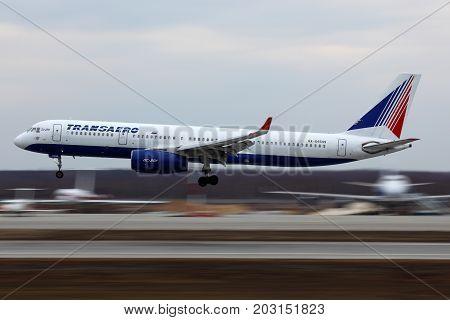 Domodedovo, Moscow Region, Russia - April 22, 2011: Transaero Tu-214 RA-64549 landing at Domodedovo international airport.