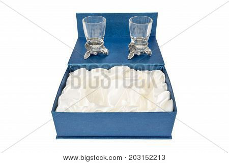 Beautiful blue gift box with two glasses for vodka with a head of a wild boar on the bottom, isolated on a white background