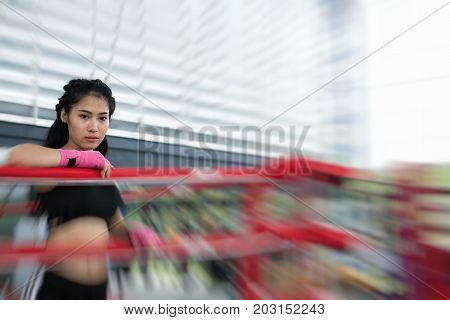 Young Woman Prepare For Exercise In Fitness Center. Female Boxer Posing In Boxing Ring In Gym. Sport