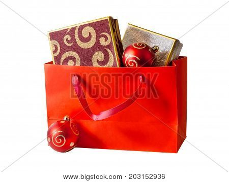 Shopping bag with gift boxes isolated on white background.