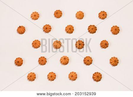 Sweet tasty cookies pattern on beige background