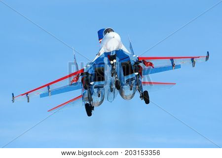 Kubinka, Moscow Region, Russia - April 1, 2011: Sukhoi Su-27 04 BLUE jet fighter of Russian Knights aerobatics team landing at Kubinka air force base.
