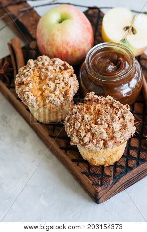Apple Cinnamon Crumble Muffins, Salted Caramel Sauce On A Wooden Board. White Stone Background. Clos