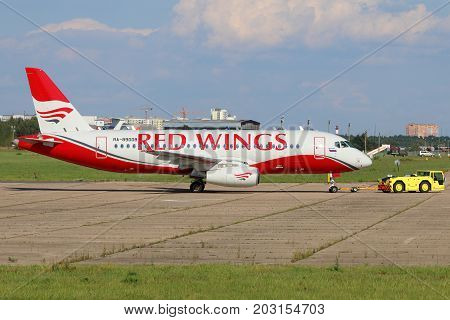 Zhukovsky, Moscow Region, Russia - July 31, 2015: Sukhoi Superjet 100 RA-89008 of Red Wings airlines at Zhukovsky.