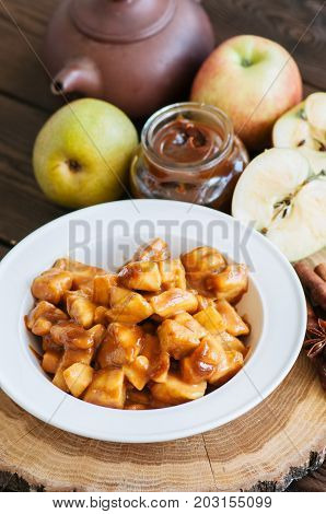 Ingredients For Apple Pie- Salted Caramel, Slices Of Apple With Caramel Sauce, Cinnamon Sticks On A