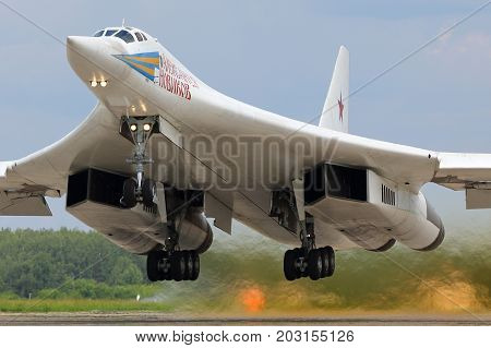 Kubinka, Moscow Region, Russia - June 22, 2015: Tupolev Tu-160M RF-94109 modern strategic bomber airplane of russian air force takes off at Kubinka air force base after Army-2015 military forum.