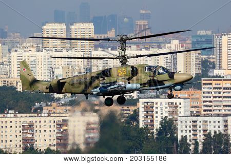 Lyubertsy, Moscow Region, Russia - July 12, 2011: Kamov Ka-52 Alligator 53 YELLOW attack helicopter of russian air force pictured over Moscow city in Lyubertsy.