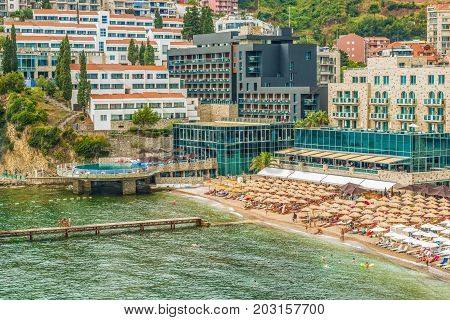 Budva, Montenegro - August 20, 2017: View of the modern beach town of Budva, Montenegro, Europe. Budva is one of the best and most popular resorts of the Adriatic Riviera.