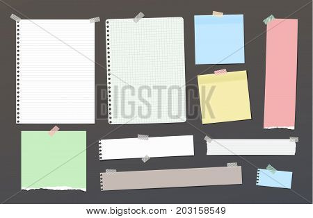 Ripped blank ruled note, notebook, copybook paper strips, sheets stuck with colorful sticky tape on dark background