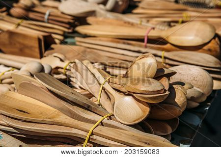 wooden spoons and handmade tools, selective focus
