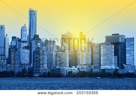 Manhattan Skyline over Hudson river New York City. Blue toned photo