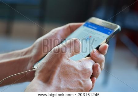 Close Up Of A Young Man Hand Searching Map On Mobile Smart Phone.