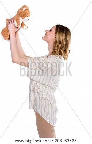 Woman Holding Up Teddy Bear