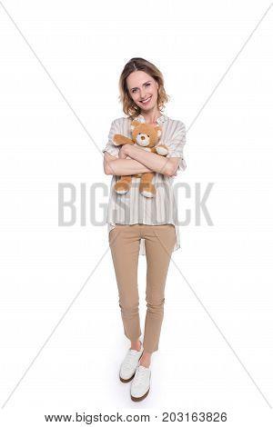 Smiling Woman Hugging Teddy Bear