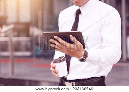 Morning Time Of Young Confident Man Economist Holding Digital Tablet Reading Email Or Looking Stock