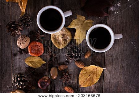 A Cup Of Coffee With Espresso And Autumn Leaves.
