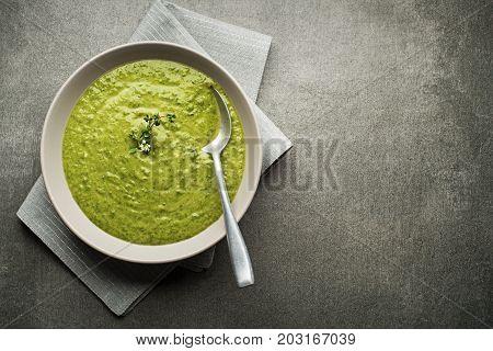 Fresh healthy vegetable green soup overhead shoot.