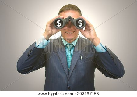 Thirst for money. Search of investment. Greed. Businessman in suit with binoculars with dollar money symbol in hand looking for money.