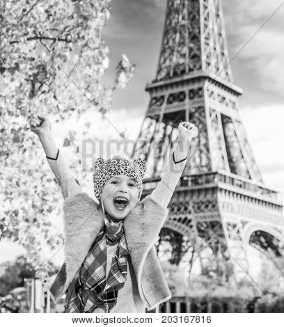 Happy Elegant Child On Embankment In Paris, France Rejoicing