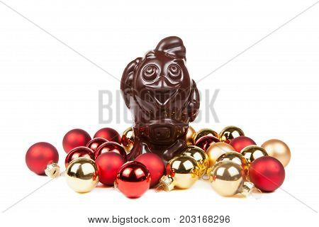 Chocolate Rooster And Christmas Red Balls Isolated On A White