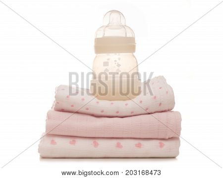 baby bottle and muslins on a white background studio cutout