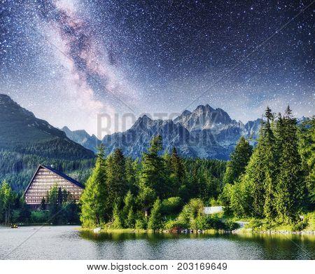 Majestic mountain lake in National Park High Tatra. Starry sky and Milky Way. Strbske pleso, Slovakia