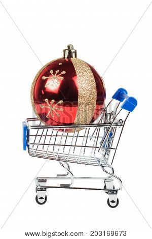 Christmas Ball In The Shopping Cart Isolated On White