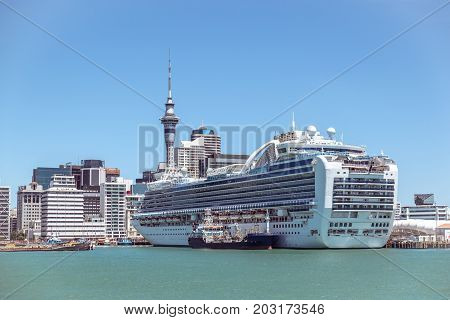 Auckland CBD city centre skyscrapers and Sky Tower with a cruise ship in New Zealand NZ