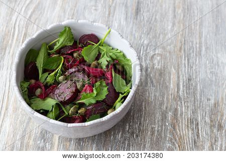 Beetroot Salad With Baked Red Onion, Capers, Watercress, Greens And Vinaigrette Sauce