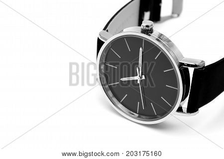 Classic wrist watch isolated over white background.
