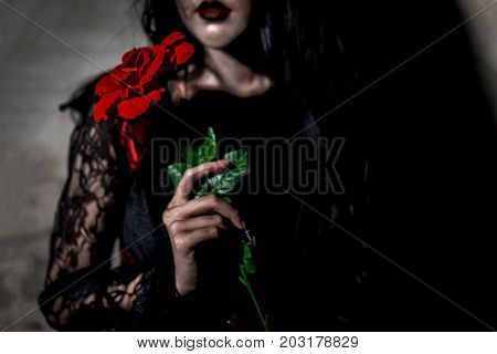 Witch woman death holding rose the ghost with blood skin is screaming darkness and nightmare background horror of scary fear on hell is monster devil girl in halloween festival concept