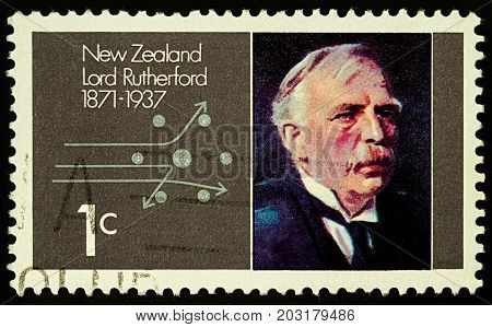 Moscow Russia - September 07 2017: A stamp printed in New Zealand shows famous physicist Ernest Rutherford and scheme of diffusion of alpha particles circa 1971
