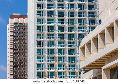 Rows of balconies on modern hotel buildings in Tel Aviv, Israel.