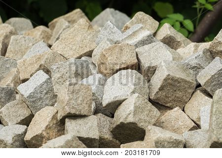 A pile of paving stones outdoor in the garden