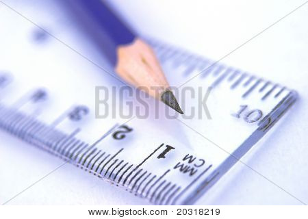 pencil and ruler,shallow depth of field,focus on tip.blue tint.Please see my gallery for similar images.