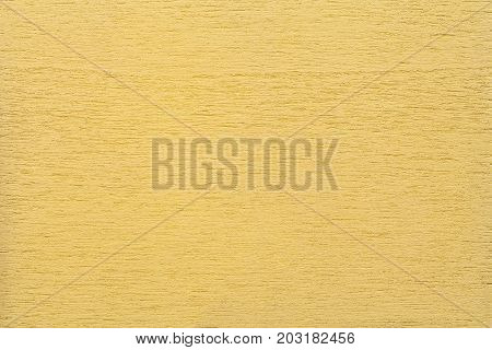 Texture of light yellow clean woody background closeup. Structure of the painted wood plywood background.