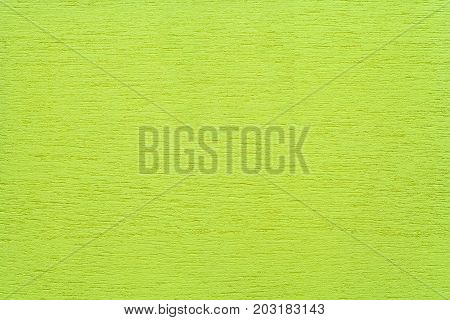 Texture of light green clean woody background closeup. Structure of the painted wood plywood background.