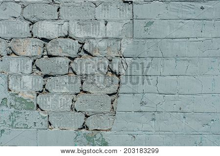 Old  Wall With Painted And Shabby Uneven Plaster. Cracked Brick Wall Background.  Vintage Brickwork