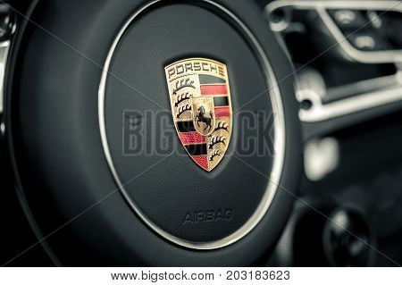 Wroclaw, Poland -  August 19Th, 2017: Emblem Of Porsche On Steering Wheel. Porsche Is A German Autom