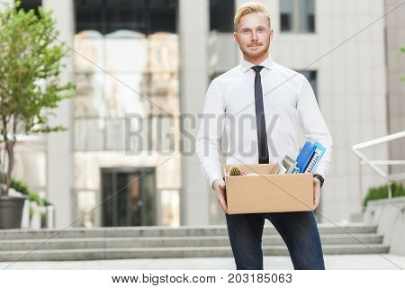 Well Dressed Young Adult Businessman, Going To New Job, Smiling And Looking At Camera